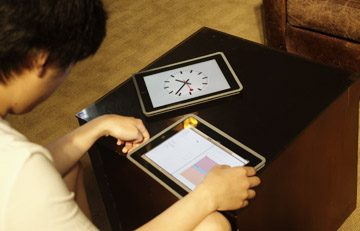 a student working on ipad with clock and schedule
