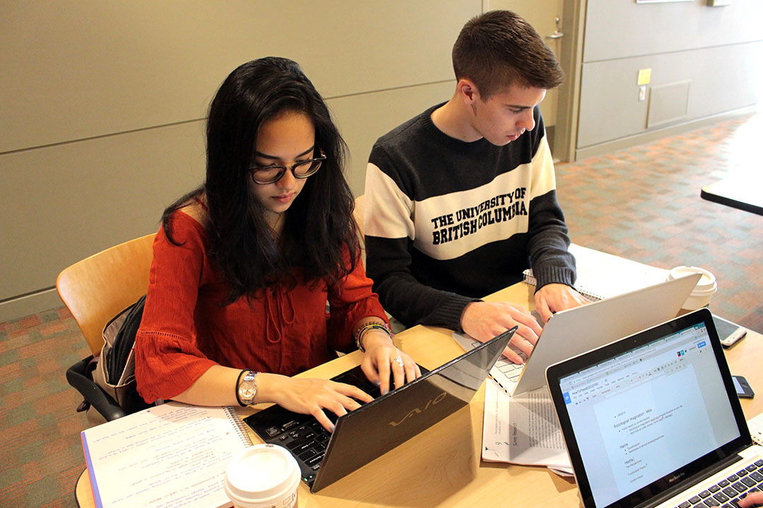 2 students studying together