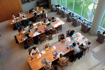 students studying at a  library space